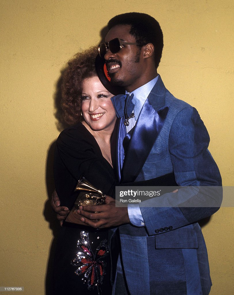 Singer Bette Midler and singer Stevie Wonder attend the 16th Annual Grammy Awards on March 2, 1974 at the Hollywood Palladium in Hollywood, California.
