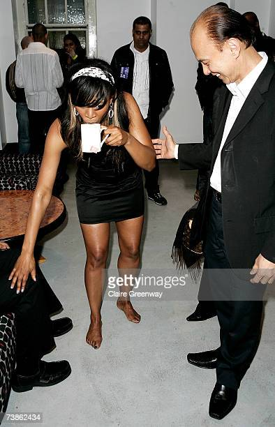 Singer Beverley Knight and footwear designer Jimmy Choo laugh backstage following Knight's performance at the Bloomsbury Ballroom on April 11 2007 in...