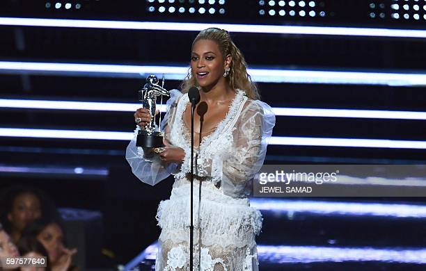US singer Beyonce accepts an award on stage during the 2016 MTV Video Music Award at the Madison Square Garden in New York on August 28 2016 / AFP /...
