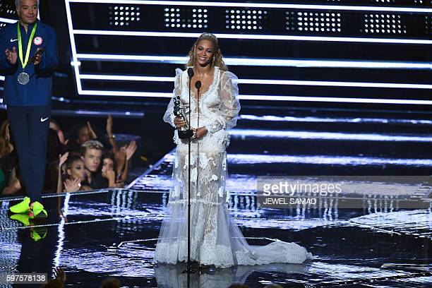 Singer Beyonce accepts an award on stage during the 2016 MTV Video Music Award at the Madison Square Garden in New York on August 28, 2016. / AFP /...