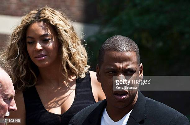 Singer Beyonce and her husband JayZ attend a rally honoring Trayvon Martin outside One Police Plaza in Manhattan on July 20 2013 in New York City...