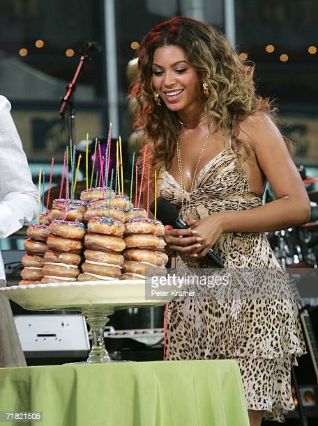 Singer Beyonce gets donuts for her birthday on the Good Morning America show in Times Square on September 8 2006 in New York City