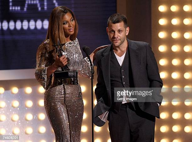 Singer Beyonce Knowles and director Anthony Mandler accept the Video of the Year award for 'Irreplaceable' during the 2007 BET Awards held at the...