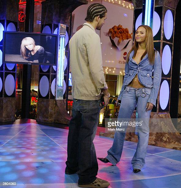Singer Beyonce Knowles and MTV VJ Quddus appear on MTV's TRL at MTV Studios in Time Square December 11, 2003 in New York City.