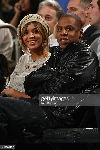 Singer Beyonce Knowles and music producer JayZ sit courtside during the NBA game between the New York Knicks and the New Jersey Nets on April 16 2007...