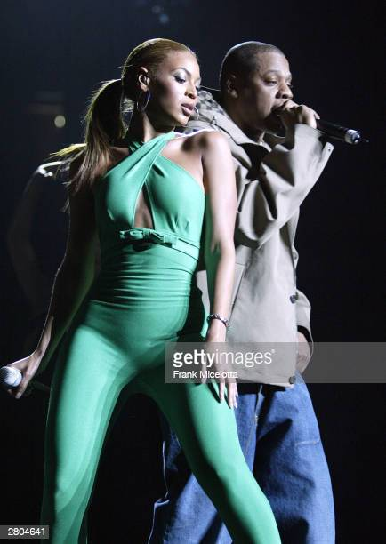 Singer Beyonce Knowles and rapper JayZ perform onstage at the Z100 Jingle Ball 2003 at Madison Square Garden December 11 2003 in New York City