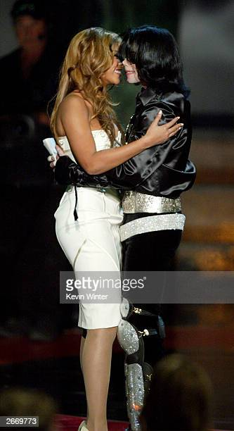 Singer Beyonce' Knowles and singer Michael Jackson winner of the 2003 Humanitarian Award hug onstage at The 2003 Radio Music Awards at the Aladdin...