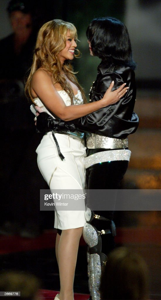 Singer Beyonce' Knowles and singer Michael Jackson, winner of the 2003 Humanitarian Award, hug onstage at The 2003 Radio Music Awards at the Aladdin Casino Resort October 27, 2003 in Las Vegas, Neveda. For more information on Jackson's humanitarian efforts, go to musicforgiving.org.