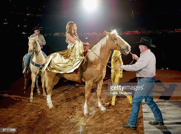 Singer Beyonce Knowles arrives on horseback to perform for her hometown crowd at the Houston Livestock Show and Rodeo March 18 2004 in Houston Texas...