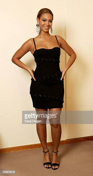 Singer Beyonce Knowles attends a photo session at the Metropolitan Hotel on October 14, 2003 in London.