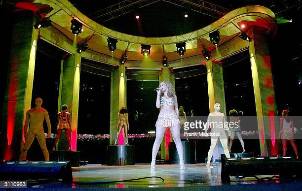 Singer Beyonce Knowles performs for her hometown crowd at the Houston Livestock Show and Rodeo March 18 2004 in Houston Texas Beyonce and her dancers...