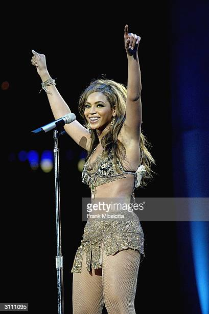 Singer Beyonce Knowles performs for her hometown crowd at the Houston Livestock Show and Rodeo, March 18, 2004 in Houston, Texas. Beyonce and her...