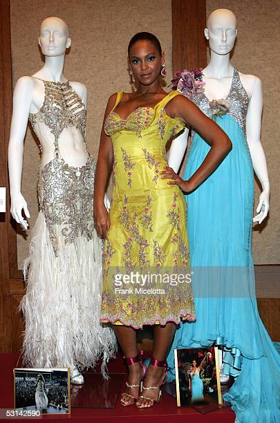 Singer Beyonce Knowles poses for a photo with manikins adorned with fashion designed by Giorgio Armani valued at 100000 and a dress designed by Dolce...