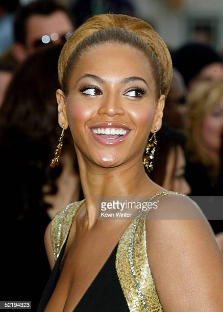 Singer Beyonce Knowles poses for a picture as she arrives to the 47th Annual Grammy Awards at the Staples Center February 13 2005 in Los Angeles...