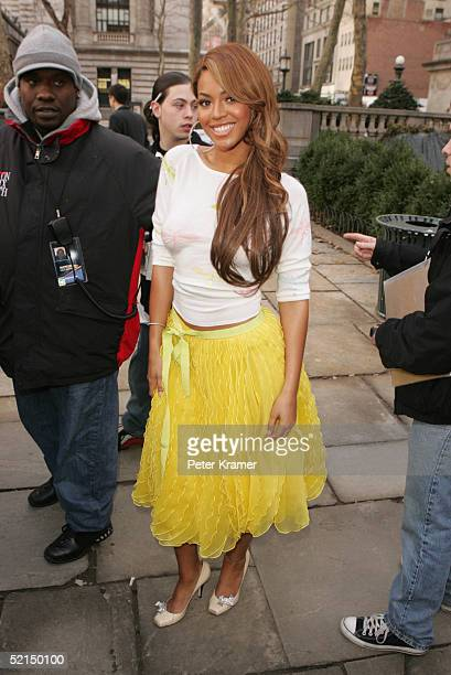 Singer Beyonce Knowles poses for photos outside the main tent during Olympus Fashion Week Fall 2005 at Bryant Park February 7 2005 in New York City