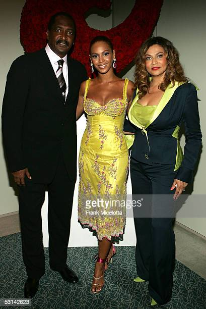 Singer Beyonce Knowles poses with her father and manager Matthew Knowles and her mother Tina Knowles at the 'Beyonce Beyond the Red Carpet auction...