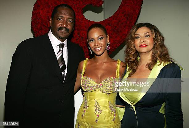Singer Beyonce Knowles poses with her father and manager Matthew Knowles and her mother Tina Knowles at the Beyonce Beyond the Red Carpet auction...