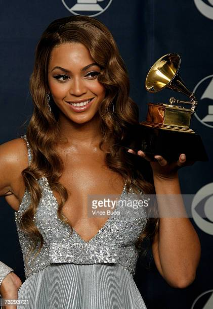 Singer Beyonce Knowles poses with her Grammy for Best Contemporary RB Album for 'B'Day' in the press room at the 49th Annual Grammy Awards at the...