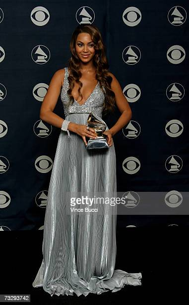Singer Beyonce Knowles poses with her Grammy for Best Contemporary RB Album for B'Day in the press room at the 49th Annual Grammy Awards at the...