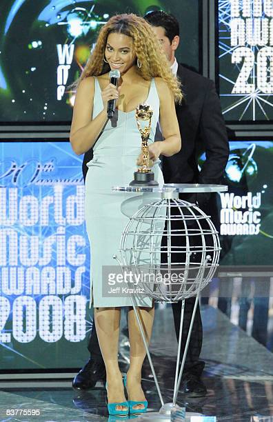Singer Beyonce Knowles poses with the award for Outstanding Contribution to the Arts at the World Music Awards 2008 at the Monte Carlo Sporting Club...