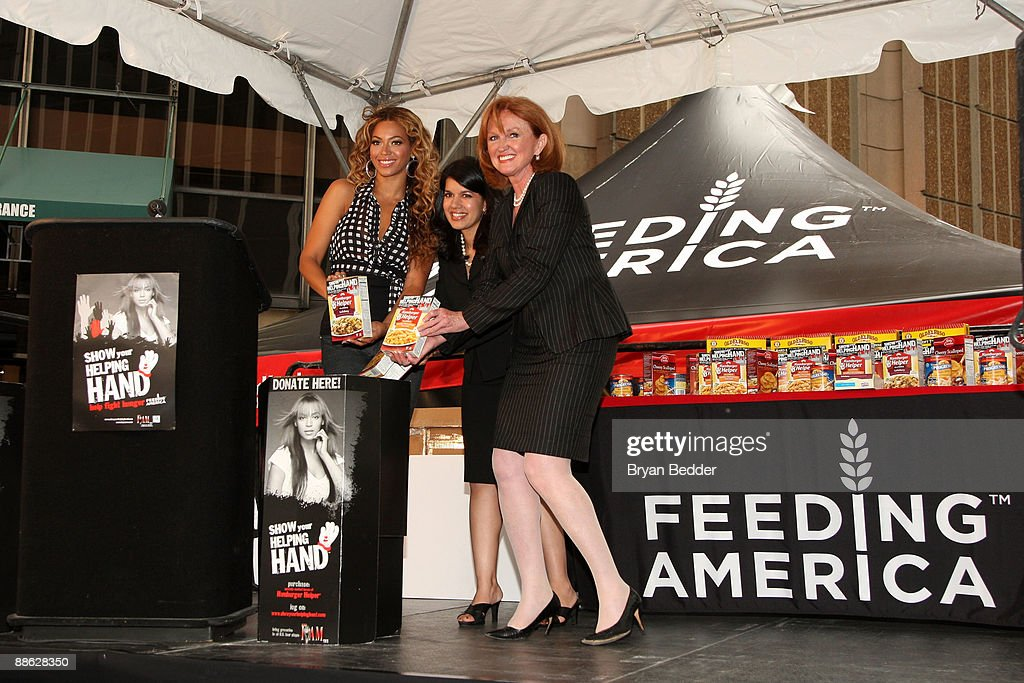 Singer Beyonce Knowles, Sarita Finnie of Hamburger Helper and Vicki Escarra of Fedding America attend the national 'Show Your Helping Hand' hunger relief initiative kickoff at Madison Square Garden on June 22, 2009 in New York City.
