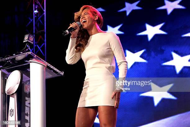 Singer Beyonce performs the National Anthem at the Pepsi Super Bowl XLVII Halftime Show Press Conference at the Ernest N Morial Convention Center on...