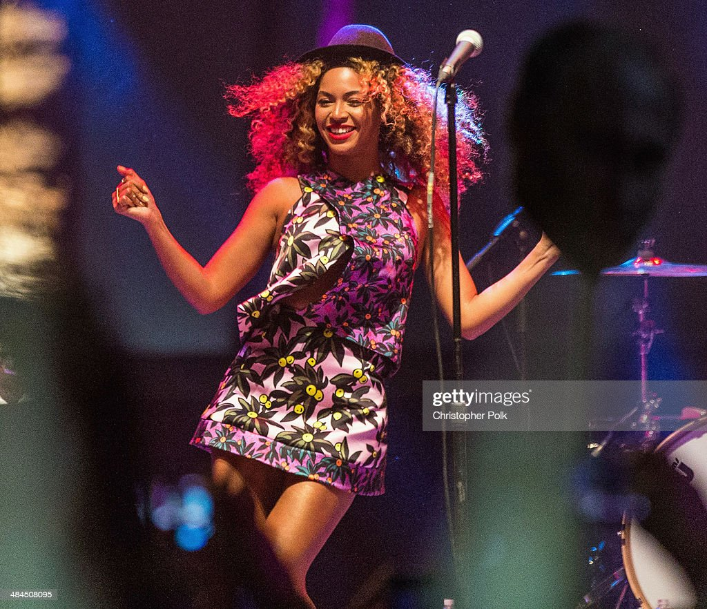 Singer Beyonce performs with her sister Solange onstage during day 2 of the 2014 Coachella Valley Music & Arts Festival at the Empire Polo Club on April 12, 2014 in Indio, California.