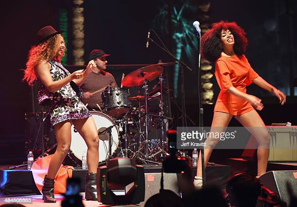 Singer Beyonce performs with her sister Solange onstage during day 2 of the 2014 Coachella Valley Music Arts Festival at the Empire Polo Club on...