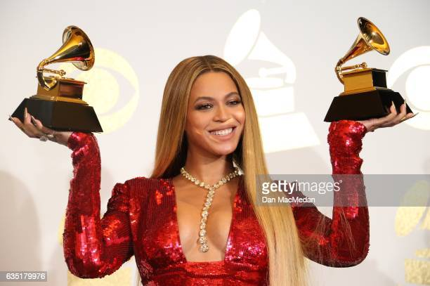 Singer Beyonce poses in the press room with her awards for Best Music Video for 'Formation' and Best Urban Contemporary Album for Lemonade' at The...