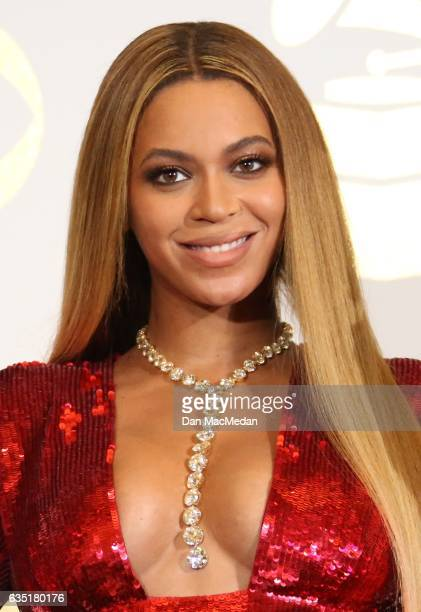 Singer Beyonce poses in the press room with her awards for Best Music Video for Formation and Best Urban Contemporary Album for Lemonade at The 59th...