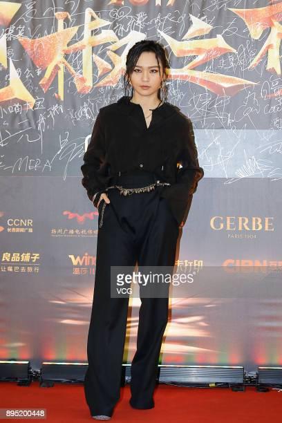 Singer Bibi Zhou arrives at 2017 Huajiao Award Ceremony on December 18 2017 in Beijing China