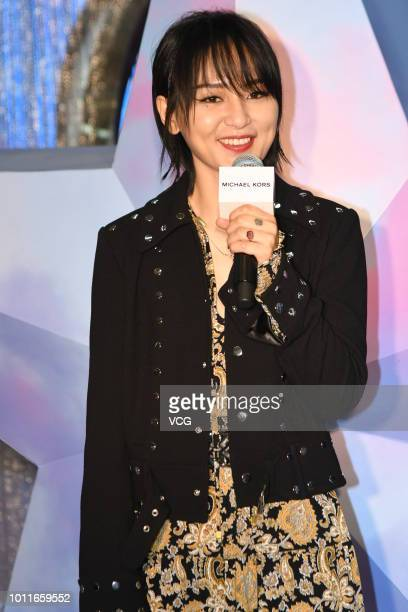 Singer Bibi Zhou attends the opening ceremony of Michael Kors Whitney popup store on August 1 2018 in Shanghai China