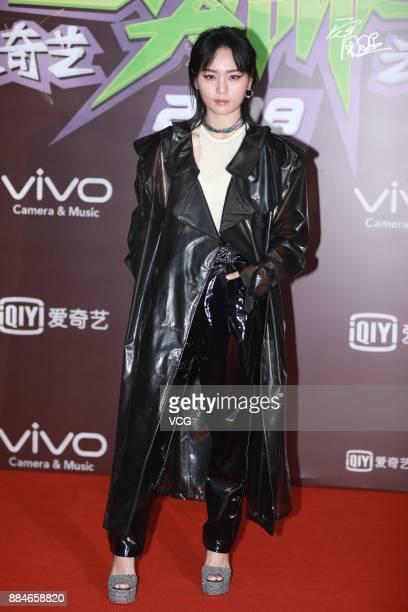 Singer Bibi Zhou Bichang poses at red carpet of the 2018 iQiyi AllStar Carnival on December 2 2017 in Beijing China