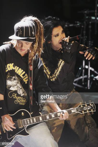 Singer Bill and guitarist Tom of the band Tokio Hotel perform at the talk and game show Wetten Dass April 1 2006 in Halle Germany