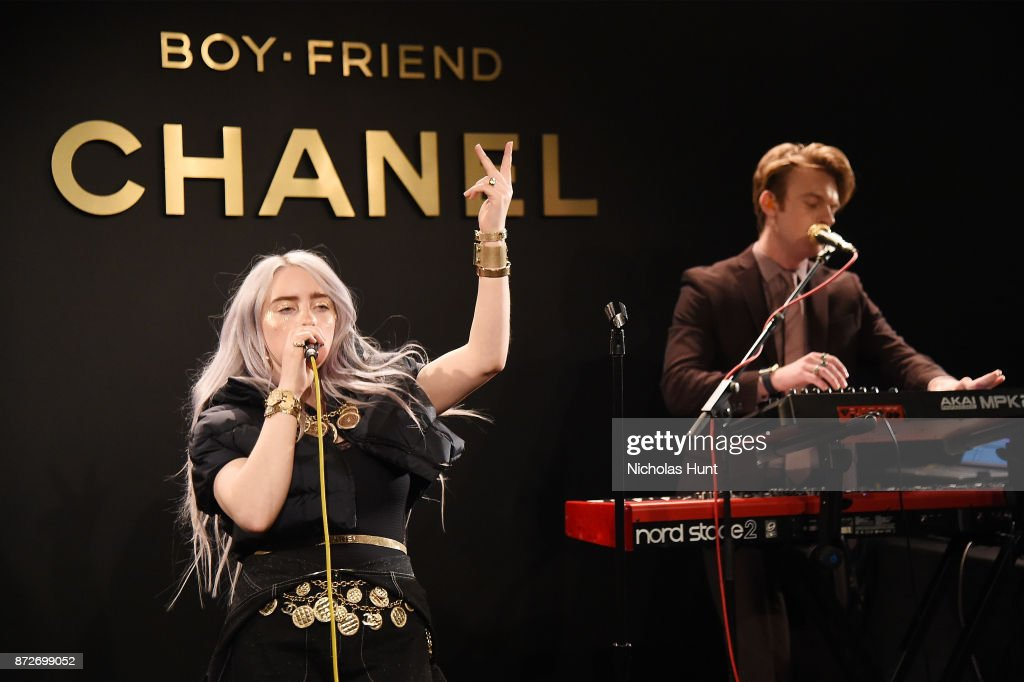 Singer Billie Eilish, wearing CHANEL, and musician Finneas O'Connell perform onstage as CHANEL celebrates the launch of the Coco Club, a Boy-Friend Watch event at The Wing Soho on November 10, 2017 in New York City.