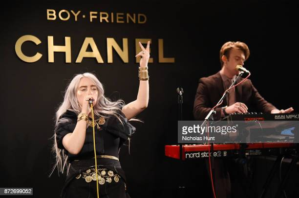 Singer Billie Eilish wearing CHANEL and musician Finneas O'Connell perform onstage as CHANEL celebrates the launch of the Coco Club a BoyFriend Watch...