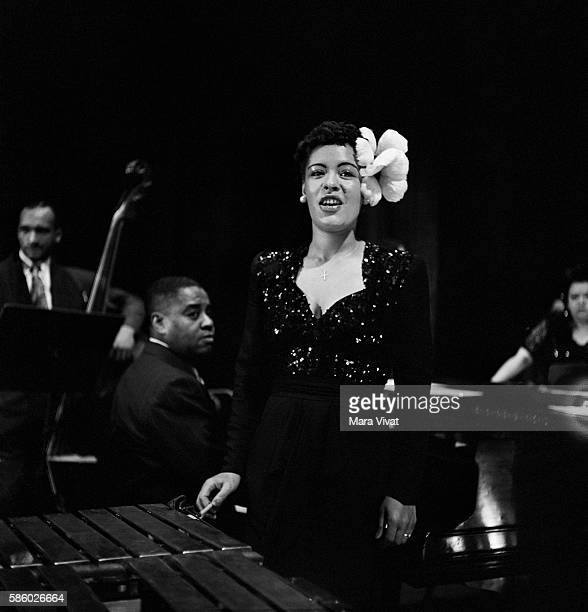 Singer Billie Holiday performs with a jazz band standing beside a xylophone New York City New York USA