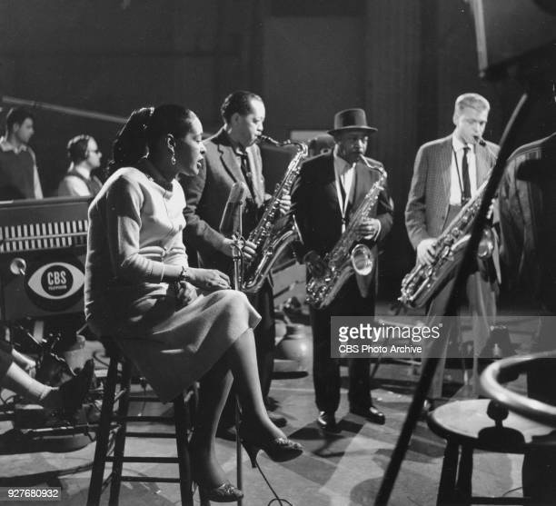 Singer Billie Holliday with musicians Lester Young Coleman Hawkins and Gerry Mulligan performs on the CBS television program 'THE SEVEN LIVELY ARTS'...