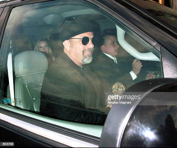 Singer Billy Joel and his new girlfriend Trish Bergin in the back seat drive away February 24 2001 after lunch at Cipriani's restaurant in New York...