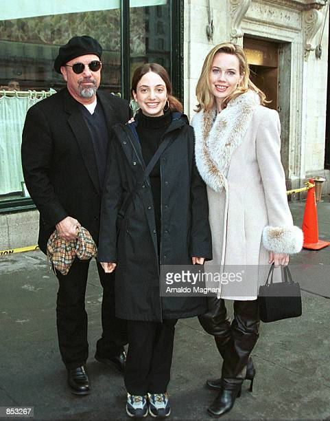 Singer Billy Joel his daughter Alexa and his new love interest Trish Bergin pose for a picture February 24 2001 after lunch at Cipriani's restaurant...