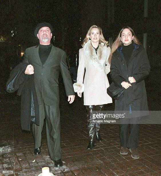 Singer Billy Joel his new girlfriend Trish Bergin and his daughter Alexa leave Vong's Restaurant February 23 2001 in New York City Joel and Bergin...