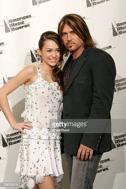 Singer Billy Ray Cyrus and daughter actress/singer Miley Cyrus pose in the press room at the 2006 American Music Awards held at the Shrine Auditorium...