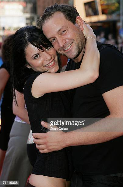 """Singer Bjoern Casapietra and his girlfriend arrive at the German premiere of """"Poseidon"""" July 11, 2006 at the Berlinale Palast in Berlin, Germany."""