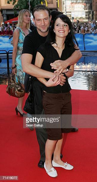 """Singer Bjoern Casapietra and his new girlfriend arrive at the German premiere of """"Poseidon"""" July 11, 2006 at the Berlinale Palast in Berlin, Germany."""