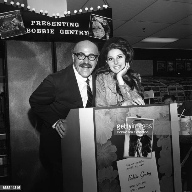 Singer Bobbie Gentry signs autographs at Korvette's record store on July 24 1968 in New York