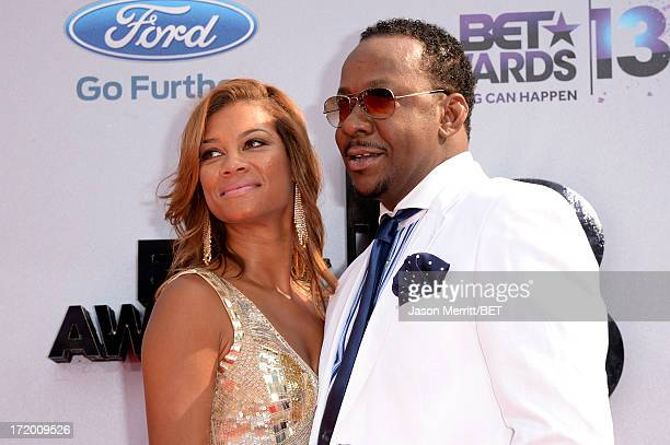 Singer Bobby Brown and Alicia Etheridge attend the Ford Red Carpet at the 2013 BET Awards at Nokia Theatre LA Live on June 30 2013 in Los Angeles...