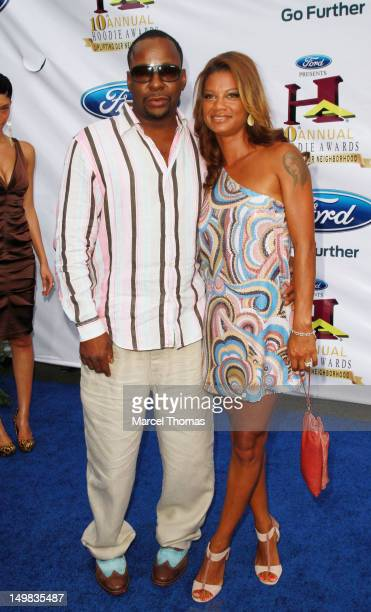 Singer Bobby Brown and wife Alicia Etheredge walk the blue carpet at the 10th Annual Ford Hoodie Awards at MGM Garden Arena on August 4, 2012 in Las...