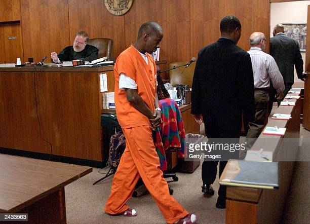 Singer Bobby Brown leaves the courtroom of Judge Wayne Purdom during his appearance before the State Court of DeKalb County on August 27 2003 in...