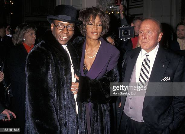 Singer Bobby Brown singer Whitney Houston and Arista Records president Clive Davis attend the 40th Annual Grammy Awards PreParty Hosted by Clive...