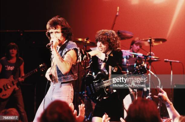 Singer Bon Scott and guitarist Angus Young of AC/DC put on a show for the crowd circa 1977 in Hollywood California In the background can be seen...